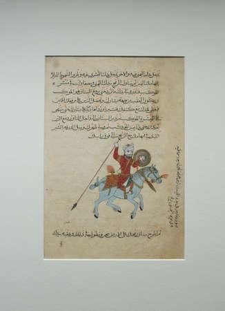 Dublin, Ireland - Feb 20th, 2020: Cavalry Skills at Manual on Arts of Horsemanship by Aqsara'i, 1366. Horseman with a shield and lance. Chester Beatty Library Banco de Imagens - 143054112