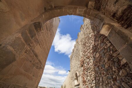 Capital Gate at Badajoz, Extremadura, Spain. Upper Horseshoe arch with visigoth hinge post where the missing door jambs were located
