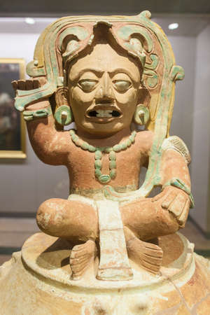 Madrid, Spain - Jul 11th, 2020: Funerary Urn depicting solar God Kinich Ahau. Detail. Museum of the Americas, Madrid, Spain
