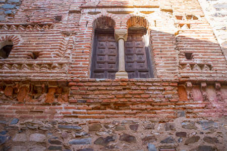 Mudejar House, Caceres, Spain. Building from the 14th century, beautiful example of the Mudejar Style which uses of red brick and the zig-zag