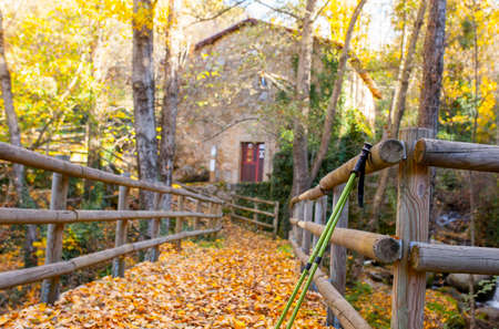 Trekking poles at old Banos de Montemayor watermill. Magic autumn of Ambroz Valley, Extremadura, Spain