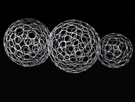 Gros plan de trois boules décoratives en métal argenté sur fond noir. Banque d'images