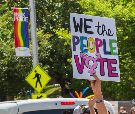 Voting sign being held up during the Pride Parade Stock Photo