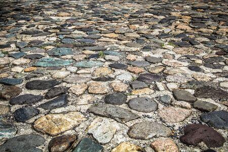 Unique, colorful, cobblestone road in Charleston, South Carolina