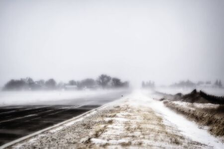 Rural country road in blizzard