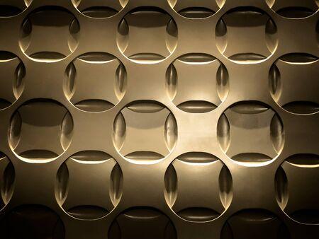 Close up of gold, circular patterned metal sheet