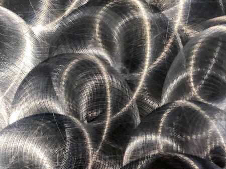 Close up of brushed metal that has circular, grungy patterns Stock Photo