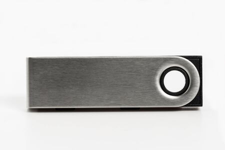 Close up of a hardware wallet unit isolated against a white background
