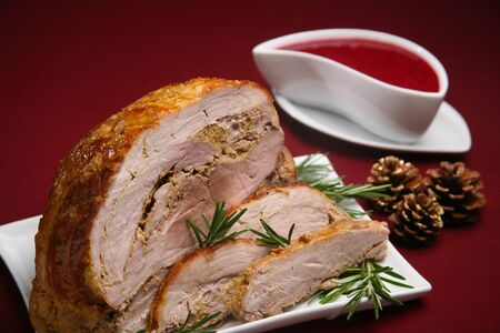Baked pork fillet with herbs and red fruit sauce Zdjęcie Seryjne