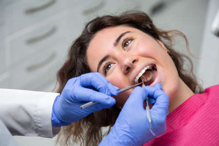 Closeup of dentist working on a girl's mouth. Stock Photo