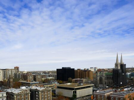City view of Denver, Colorado with a bright blue sky and cirrocumulus clouds