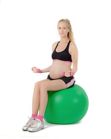 Pregnant Woman Fitness Exercise. Bicep Curl Stock Photo