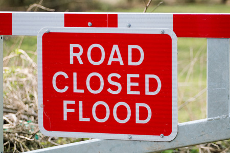 road closed: Road Closed Flood Warning Sign on Barrier