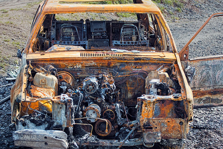 rusty car: Burnt Out Rusty Car. Abandoned Wreck Stock Photo