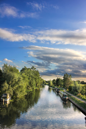 holidaying: Canal and narrow boats on sunny evening Stock Photo
