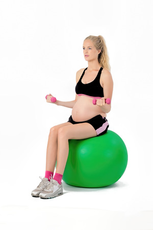 Pregnant Woman Fitness Weights Exercise. Stock Photo