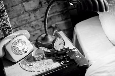 melodrama: Gun on bedside table. Film Noir Stock Photo