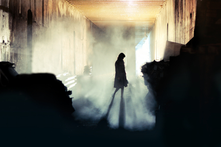 Mysterious Woman. Mystery Woman In Mist Silhouette Archivio Fotografico