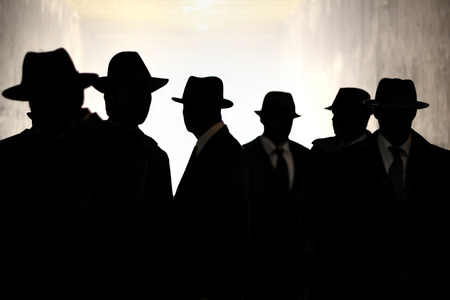 Men in fedora hats silhouette. Security, Privacy, Surveillance Concept.