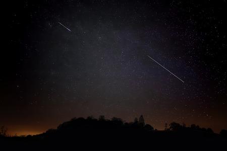 Pair of Meteors. Meteor Shower Night Sky Landscape Silhouette Imagens