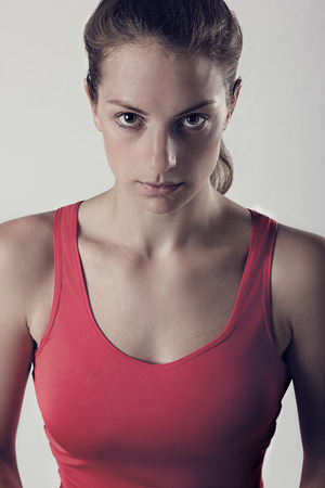 gritty: Sports Woman With Look Of Determination. Dark Gritty Portrait Stock Photo