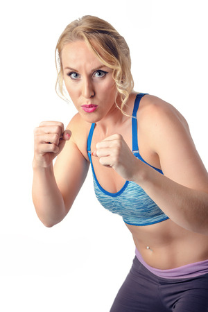 defensa personal: Strong Healthy Fitness Woman Punching. Boxing, Martial Art, Self Defense