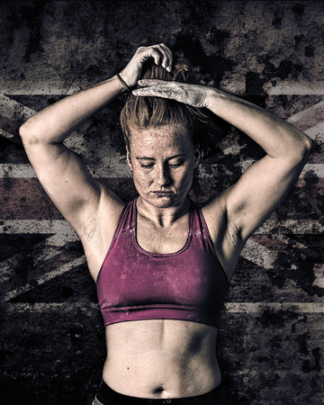 gritty: Female Athlete. Sports Woman. Gritty Grunge Style, UK Flag Background. Stock Photo