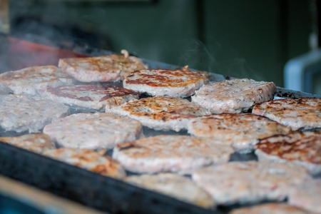 Burgers Cooking On Grill At Street Food Stall Stock Photo