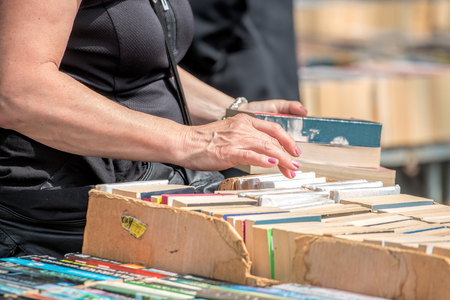 second hand: Second Hand Book Stall. Woman Buying Books Stock Photo