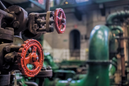 Red Valve Wheel and Industrial Pipes Imagens