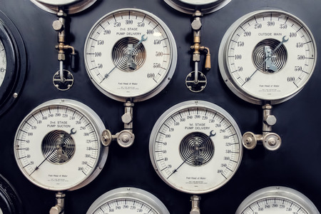 steam output: Analogue Gauges. Industrial Era Water Steam Measurement. Stock Photo