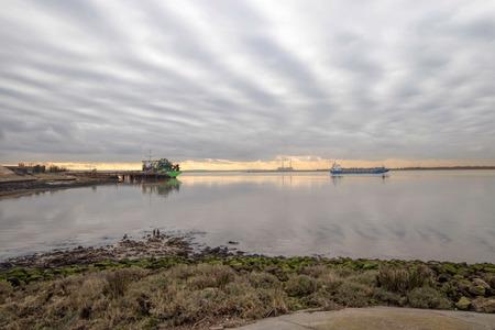 Industrial river landscape. Cargo ship Imagens