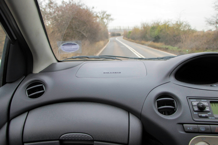 Car interior and road. Passenger view.