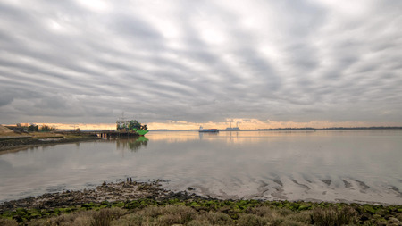 Industrial river landscape panorama. Cargo ship Stock Photo