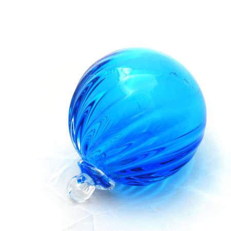 ridged: Ridged clear blue blown glass ball ornament. Stock Photo