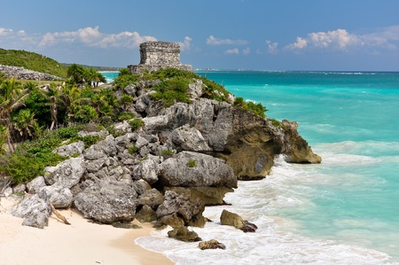 tulum: Beautiful beach in Tulum Mexico, Mayan ruins on top of the cliff  Stock Photo
