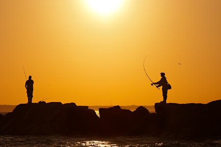 fishermens at sunset photo
