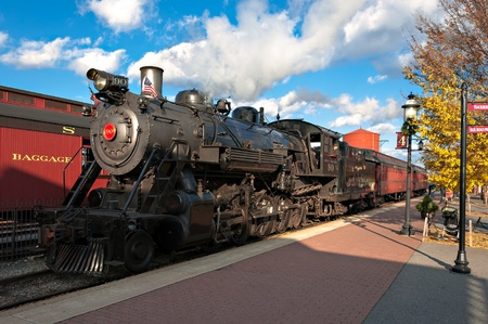 The steam engine train arrives the station