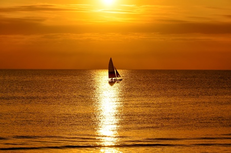 yacht with golden sunset in Cape May photo