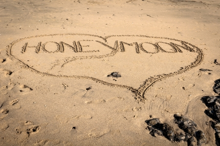 Honeymoon written on the sand in the outline of a heart Banco de Imagens - 14474074
