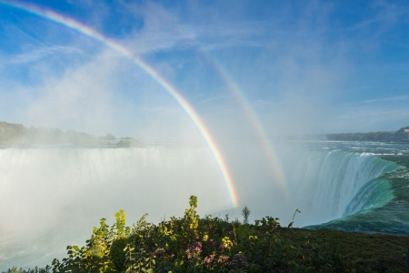 spectacular rainbow in the mist of Niagara Falls