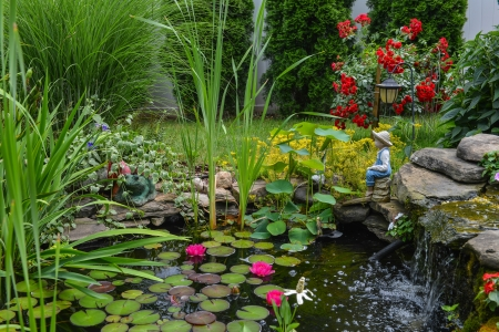 water feature: This is a close view of the water pond feature with the statue