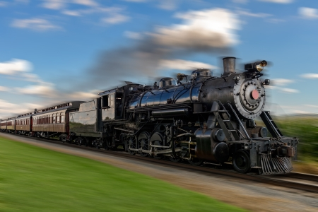 historic steam train passes through the fields 2 photo