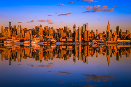 Manhattan at sunset reflected in the hudson river Stock Photo