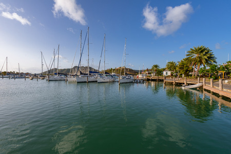 windward: Yachts and power boats anchored in crystal clear turquoise waters in the Caribbean