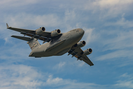 windsor: NEW WINDSOR, NY - SEPTEMBER 3, 2016: Giant C-17 Globemaster III taking off at Stewart International Airport during the New York Airshow.