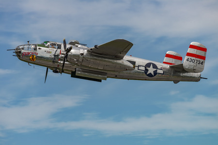 NEW WINDSOR, NY - SEPTEMBER 03, 2016: Panchito is a North American B-25 Mitchell from the Word War II Era flying over Stewart Airport at the New York Airshow