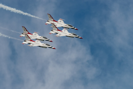 squadron: NEW WINDSOR, NY - SEPTEMBER 3, 2016: USAF Thunderbirds perform at the Stewart International Airport during the New York Airshow. Squadron is the official air demonstration team for the United States Air Force Editorial