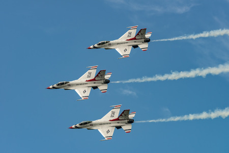 usaf: NEW WINDSOR, NY - SEPTEMBER 3, 2016: USAF Thunderbirds perform at the Stewart International Airport during the New York Airshow. Squadron is the official air demonstration team for the United States Air Force Editorial