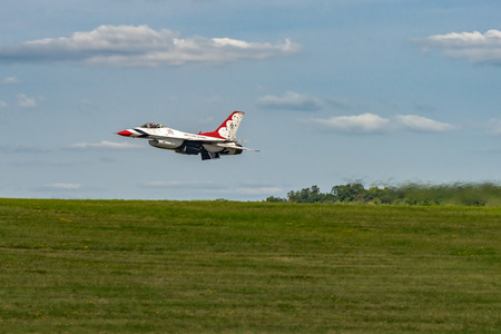 united states air force: NEW WINDSOR, NY - SEPTEMBER 3, 2016: USAF Thunderbirds perform at the Stewart International Airport during the New York Airshow. Squadron is the official air demonstration team for the United States Air Force Stock Photo